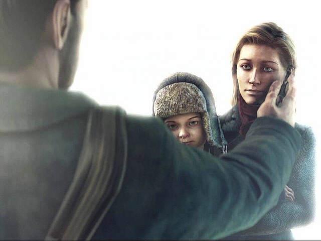 Screenshot de Jo passant la main sur le jouer de sa femme, elle-même tenant leur fils de 5 ans max dans les bras.