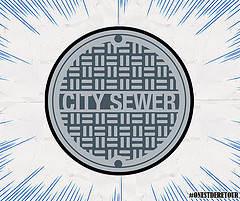 """image d'une plaque d'égout marquée """"City Sewer"""""""